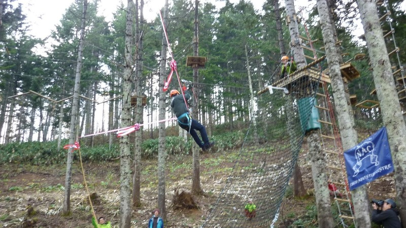 Ribbon cutting via zip line at nac adventure park