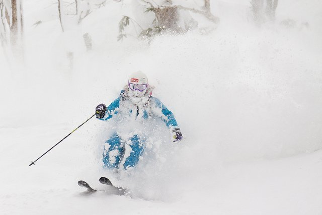 a skier enjoys the deep snow to start the winter in niseko