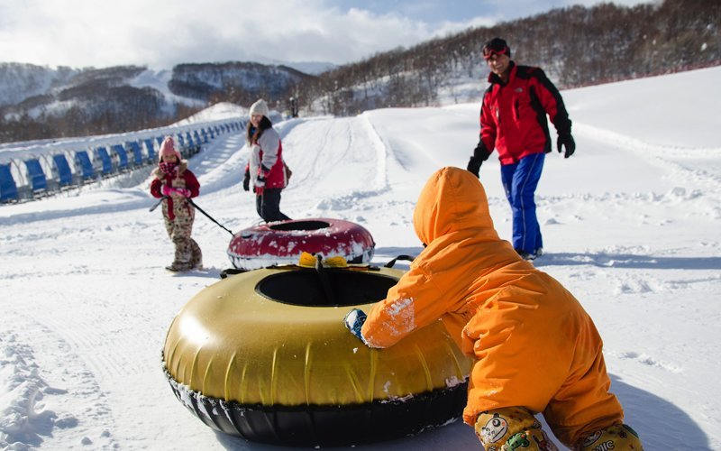 family snow tubing at hanazono niseko resort