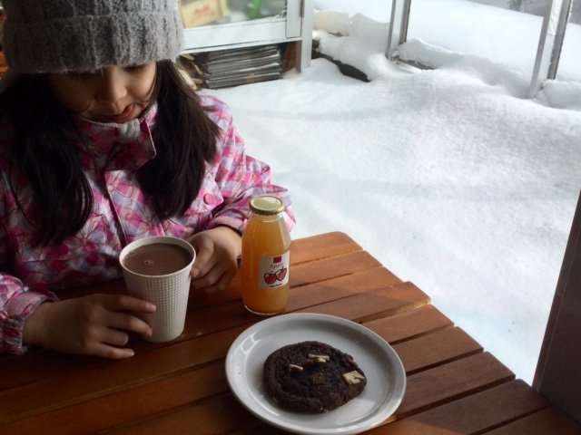 enjoying hot chocolate after niseko grand hirafu kids park