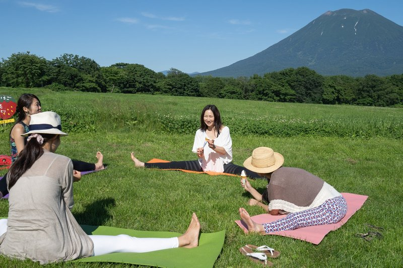 Girls practicing yoga in Niseko