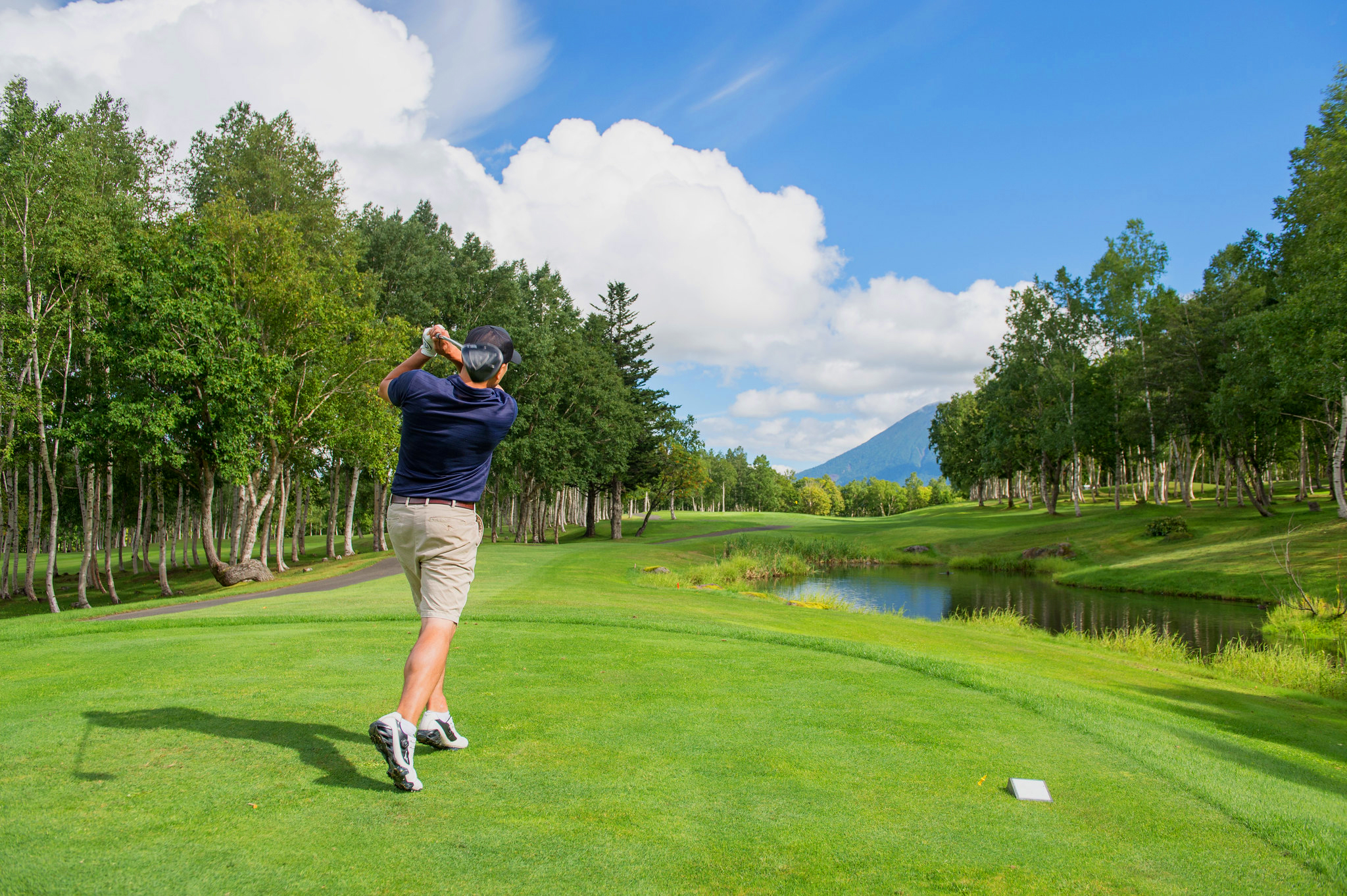 A man playing golf in Niseko at HANAZONO Golf course