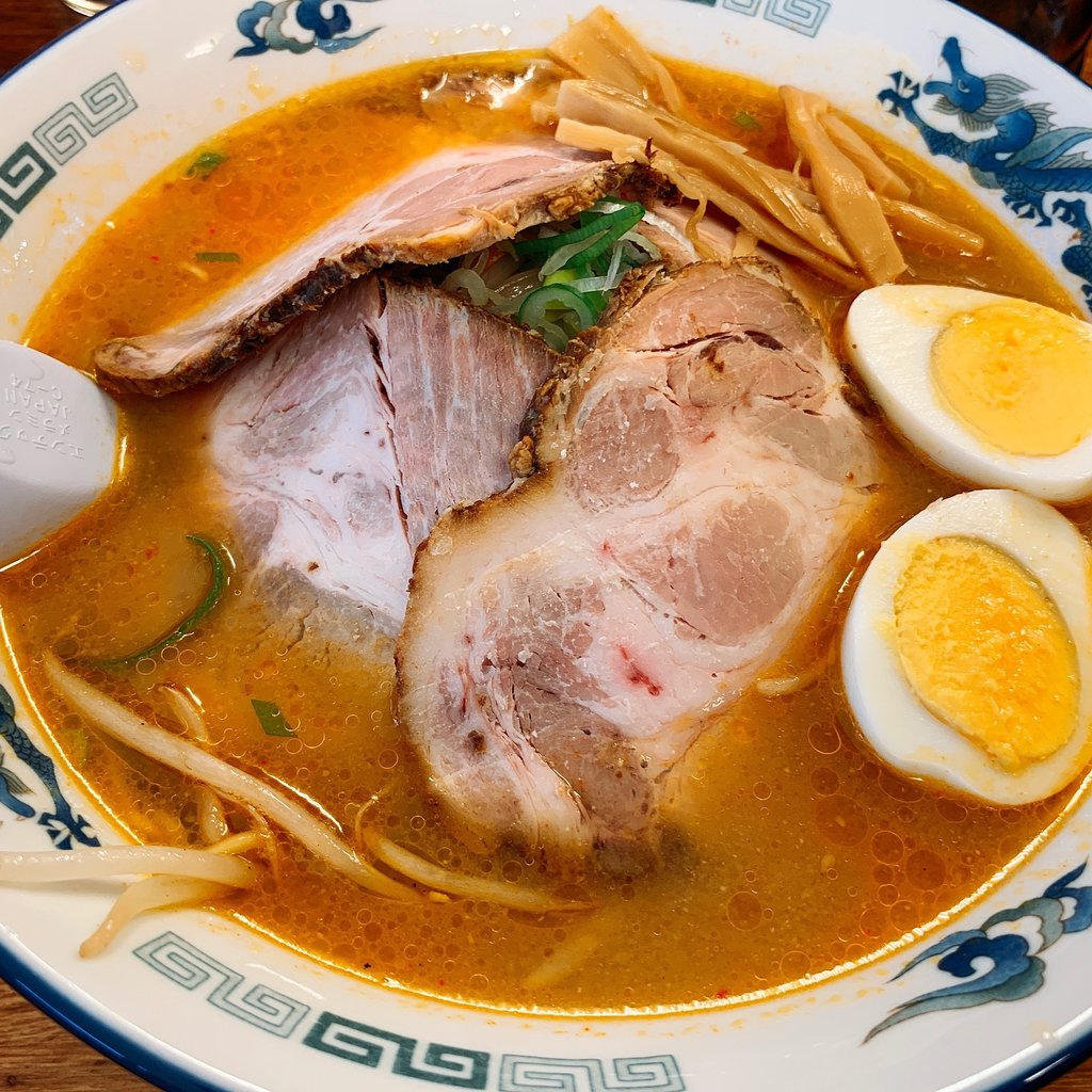 A bowl of ramen with pork and boiled eggs at Tozanken in Niseko.