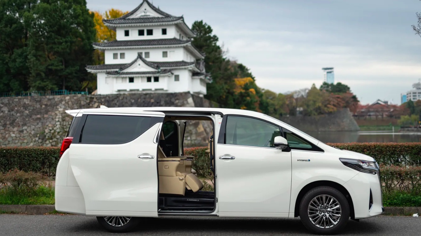 A Toyota Alphard in front of a pagoda in Japan.