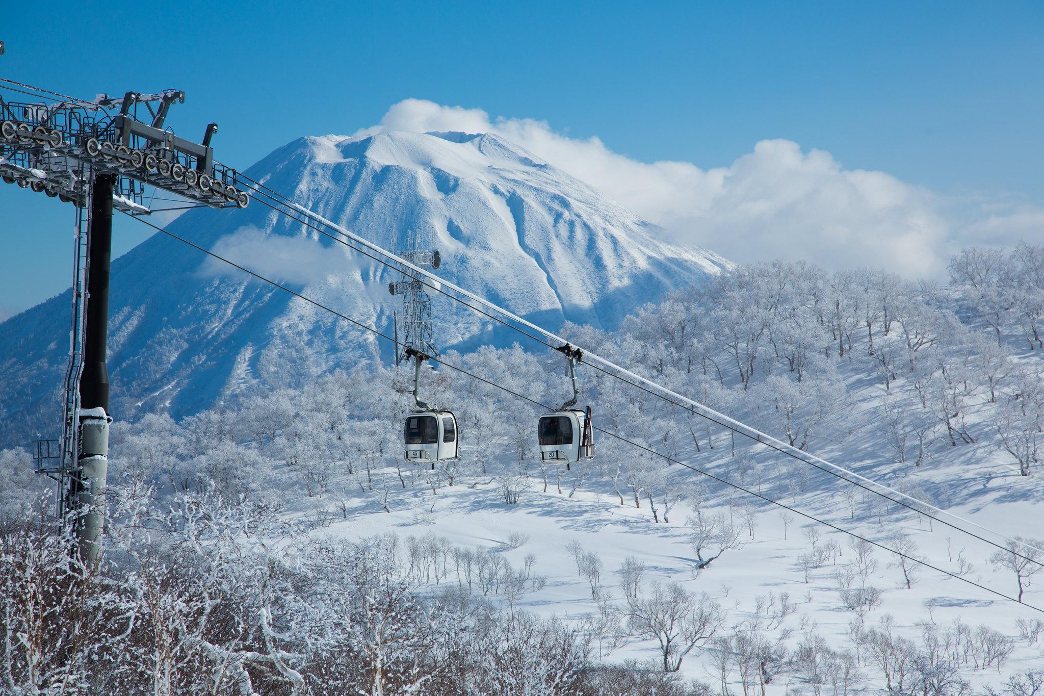 A gondola in Niseko overlooking Mt Yotei on a bluebird day.