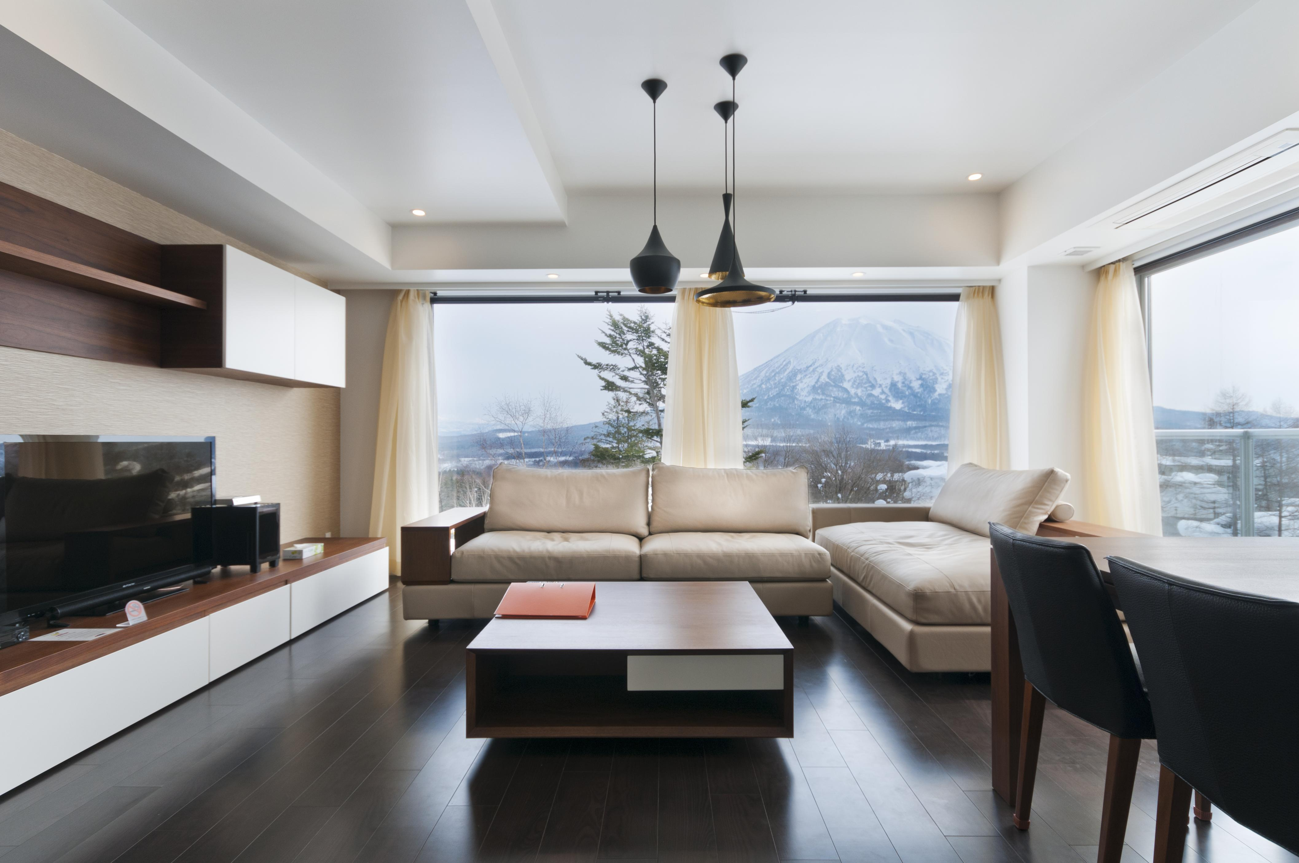 The living room with a view of Mt Yotei in a 2 bedroom apartment in Kizuna, Niseko.