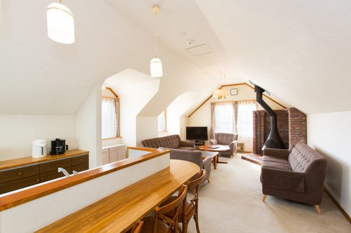 The living and dining area of Heritage Townhouse in Niseko.