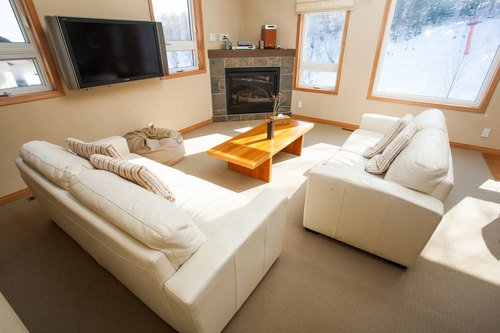 The living area with fireplace in a 3 bedroom apartment at Alpine Apartments in Niseko.