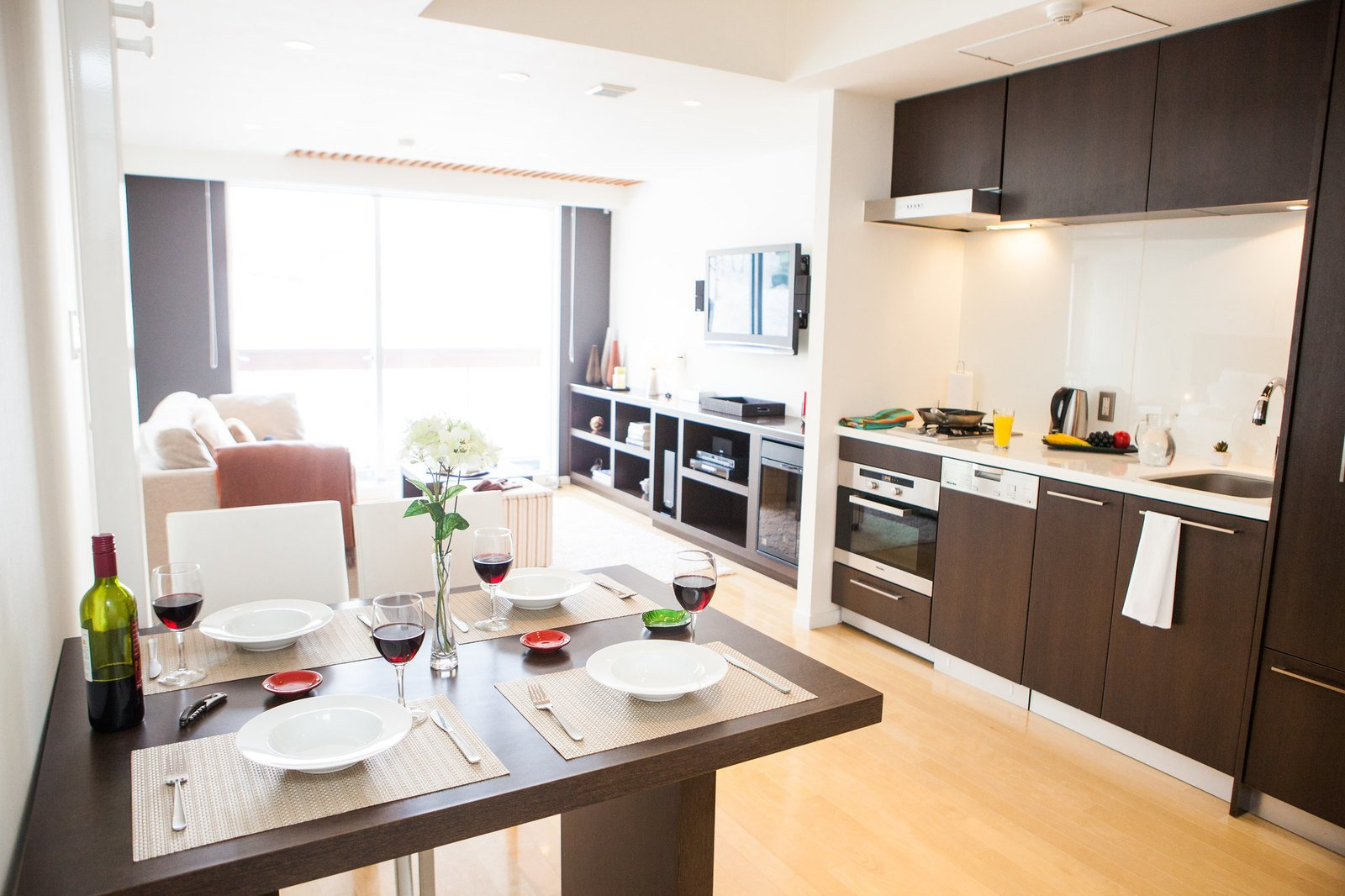 The kitchen, living and dining areas of a 1 bedroom apartment at Alpen Ridge apartments in Niseko, Japan.
