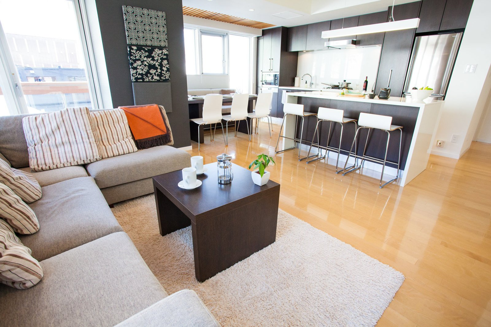 The kitchen, living and dining areas of a 3 bedroom apartment at Alpen Ridge apartments in Niseko, Japan.