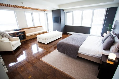 The master bedroom with lounging area in a 4 bedroom apartment at Alpen Ridge apartments in Niseko, Japan.