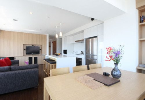 The living and dining area of a 2 bedroom apartment with Yotei view at Snow Crystal in Niseko.