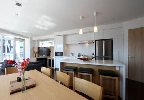 The kitchen and dining areas of a 2 bedroom apartment at Snow Crystal in Niseko.