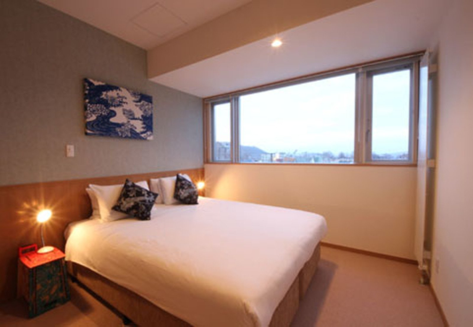 The master bedroom in a 3 bedroom apartment with Yotei view at Snow Crystal apartments in Niseko, Japan.
