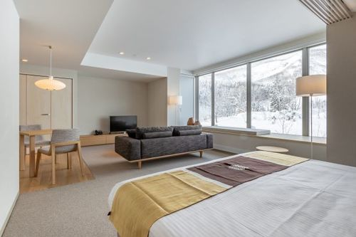 The bedroom/living area in a Mountain Studio apartment in The Maples, Niseko.