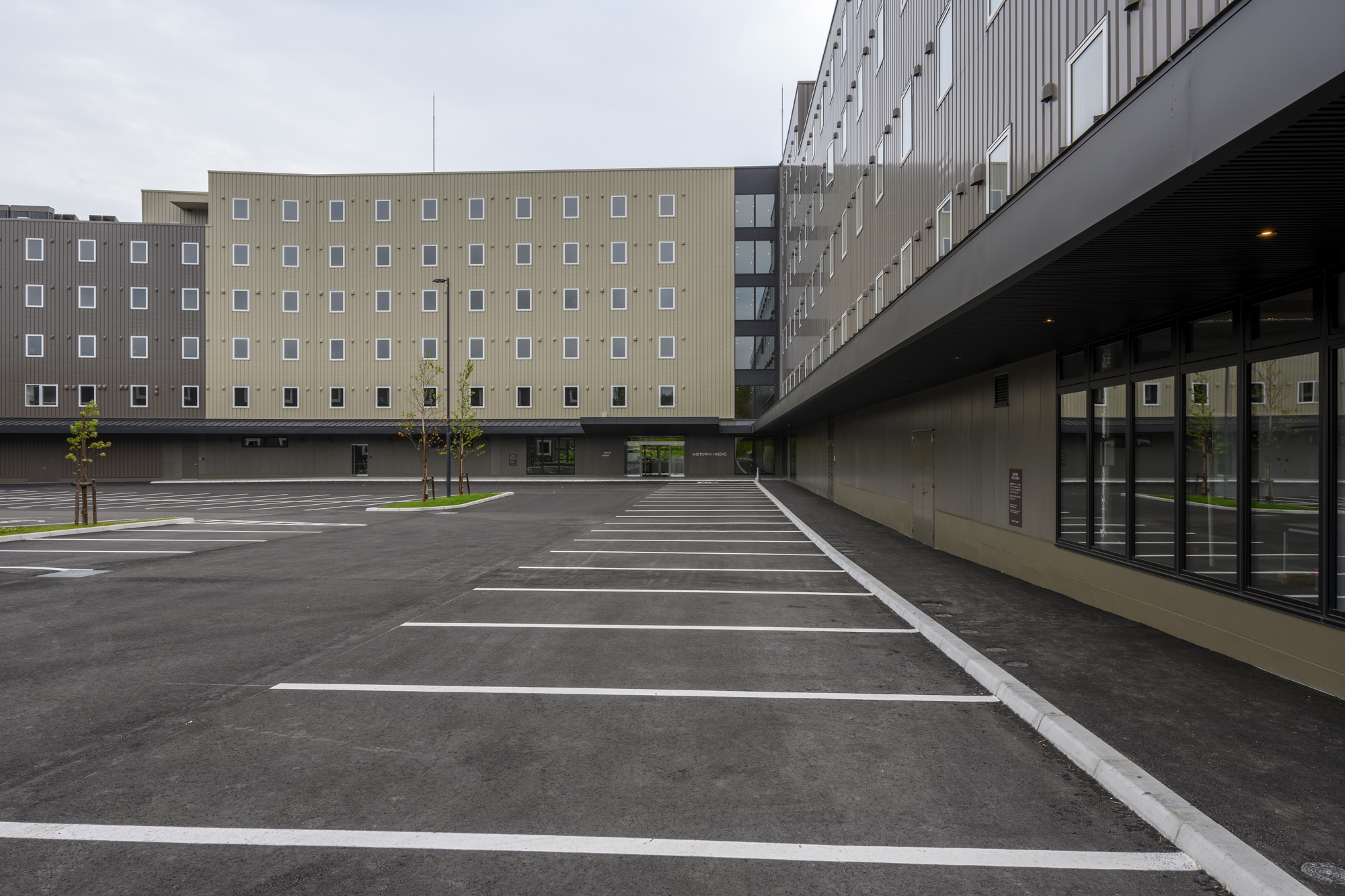 Parking spaces and external area of Midtown Niseko.